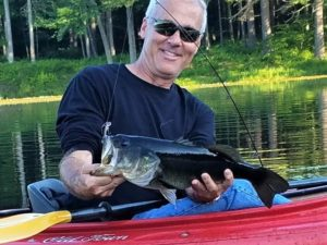 Pete Schoenberger shows off a bass he caught in Fitzgerald Lake.